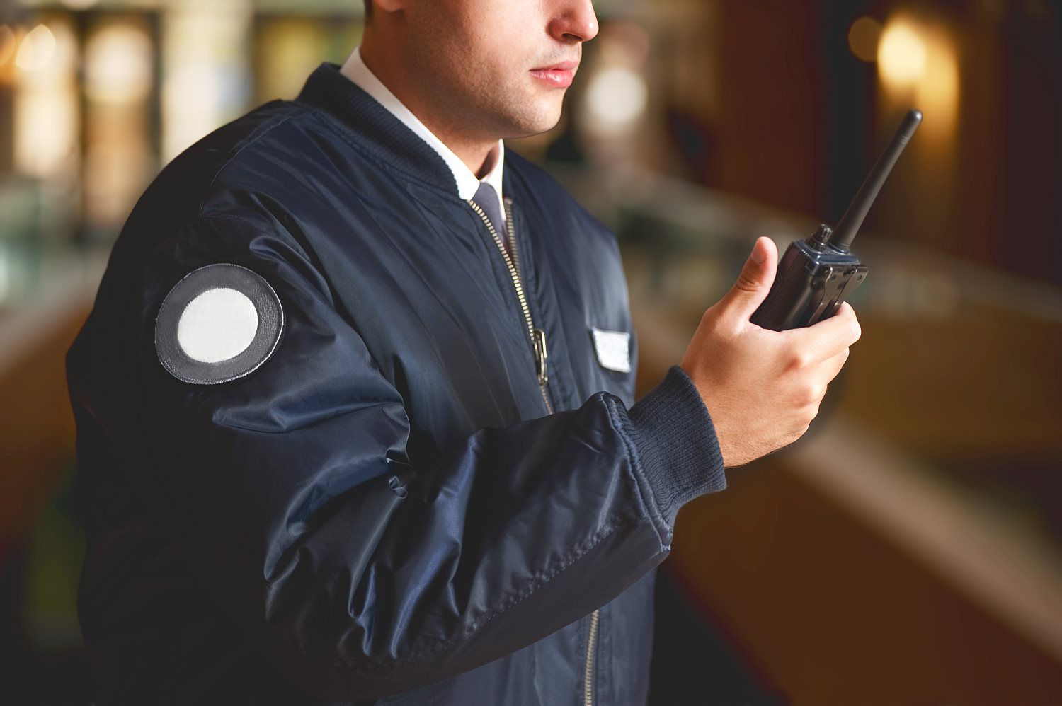 Security Guard holding a radio